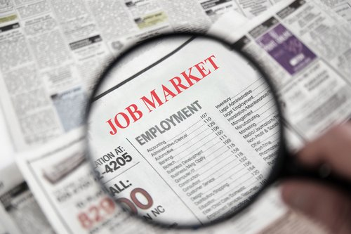 jobs market with magnifying glass