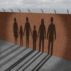 immigrant kids behind barbed fence