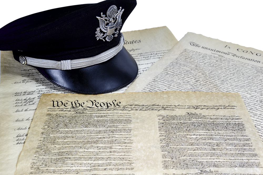 military hat and Constitution documents