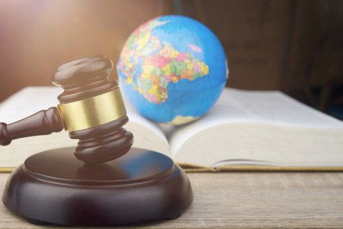 climate change concept with gavel and globe