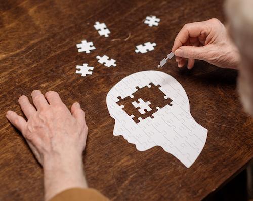 dementia concept with puzzle pieces