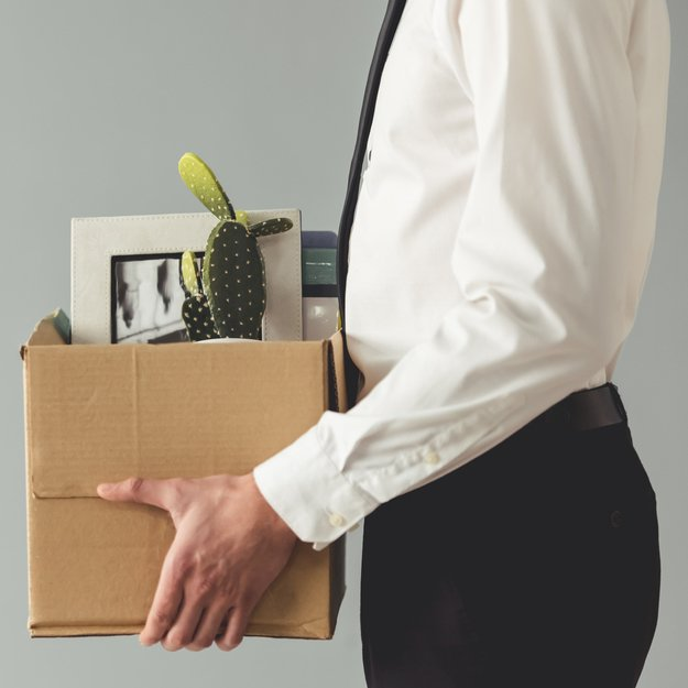 man in suit with box