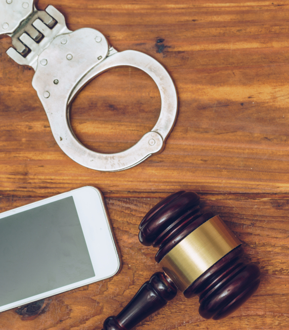 gavel, cellphone and handcuffs