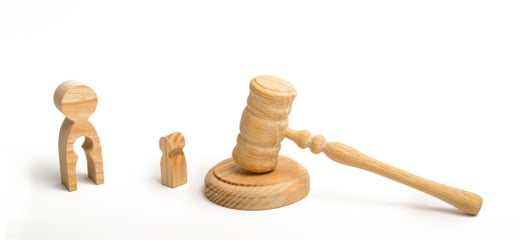 gavel with wood figurines