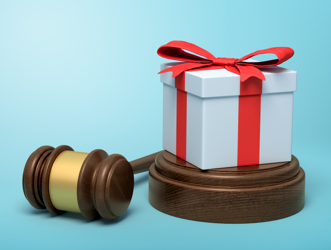 present box sitting next to gavel