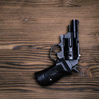 gun laying on desk