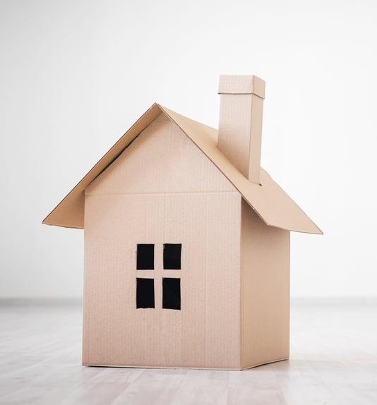 homelessness concept cardboard box house
