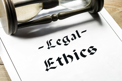 legal ethics words with hour glass