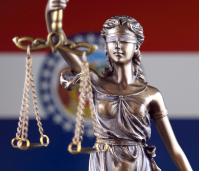 lady justice and missouri flag