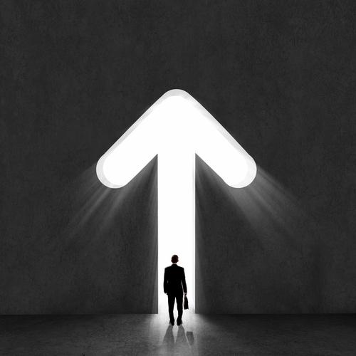 leadership concept with man walking through arrow