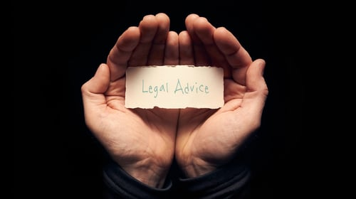legal advice note in hands