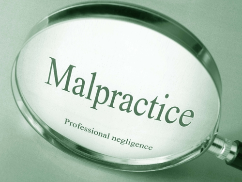 malpractice words with magnifying glass