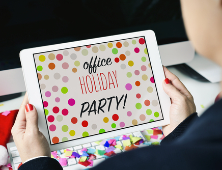 office holiday party words on tablet screen