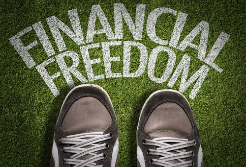 student loan relief concept with shoes and financial freedom words