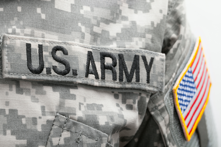 US Army uniform shirt and flag patch on the arm.