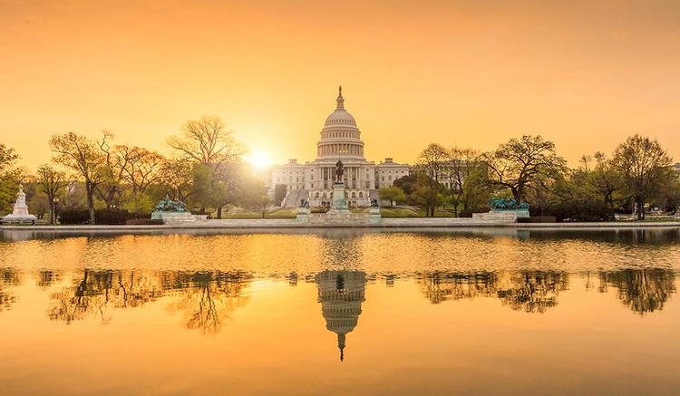 US Capitol building at sunrise.