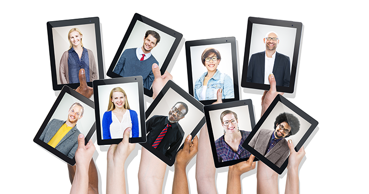 People holding up tablets with smiling photos