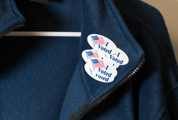 Kansas election chief charges 2 more with voter fraud