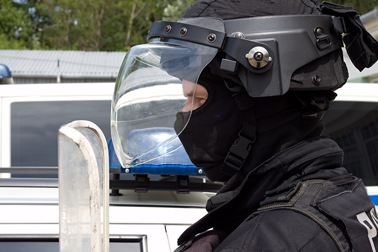 Side profile of a policeman wearing riot gear