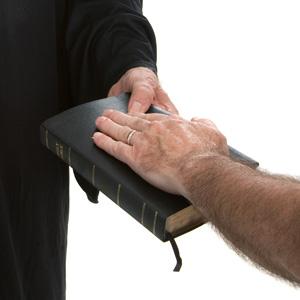 Witness taking oath