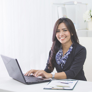 Woman sitting at computer smiling
