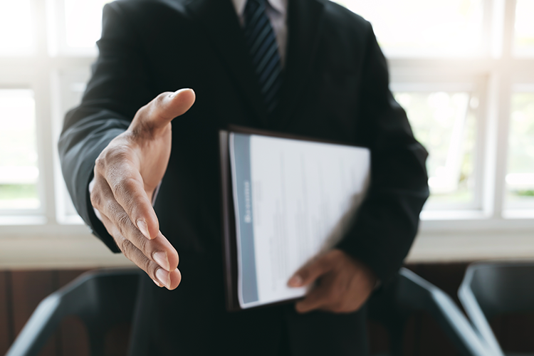 businessman with hand extended to shake